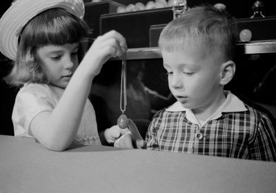 Children looking at Fabergé egg pendant